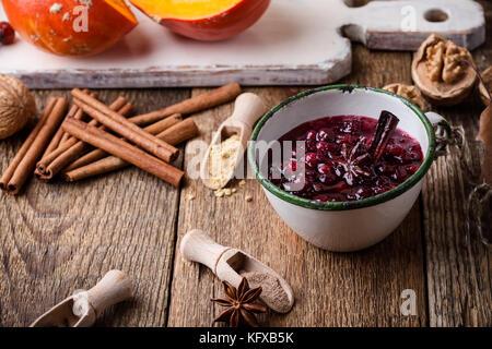 Homemade cranberry sauce in rustic mug, preparation Thanksgiving dinner - Stock Photo