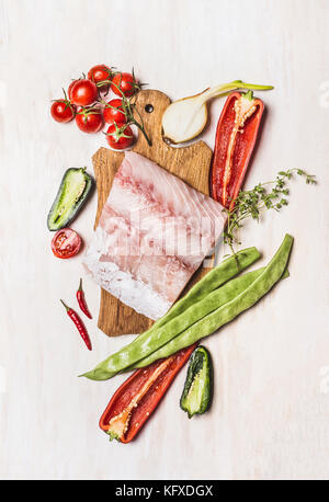 Top view of raw fish fillet  with fresh vegetables ingredients for tasty cooking - Stock Photo