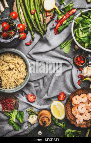Healthy salad with asparagus and cooked quinoa seeds, preparation on rustic background with various organic vegetables, - Stock Photo