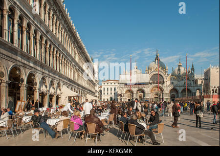 Outdoor restaurant at Piazza San Marco in Venice, Italy. - Stock Photo