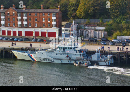 Newcastle, United Kingdom - October 5th, 2014 - UK border force cutter HMC Searcher at her moorings with RIB patrol - Stock Photo