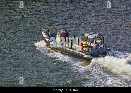 Newcastle, United Kingdom - October 5th, 2014 - UK border force RIB patrol boat with crew member - Stock Photo