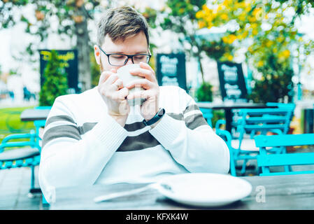 couple sitting in cafe outaside - Stock Photo