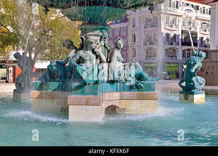 Bronze fountain with mytholoical figures in downtown Lisbon - Stock Photo