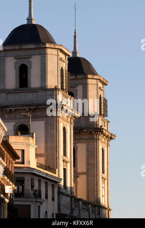 Towers from colegiata de San Isidro with afternoon light (Madrid, Spain). - Stock Photo