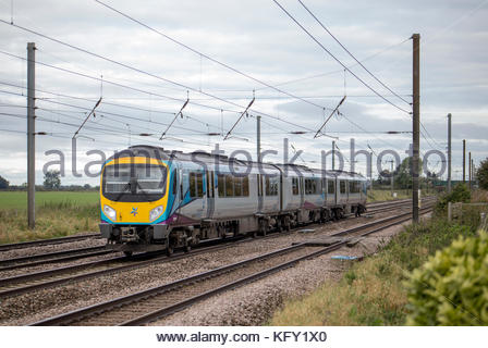 Class 185 TransPennine Express train bound for Newcastle, just north of York, Yorkshire, England - Stock Photo