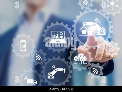Smart factory and industry 4.0 concept with connected production robots exchanging data with internet of things - Stock Photo