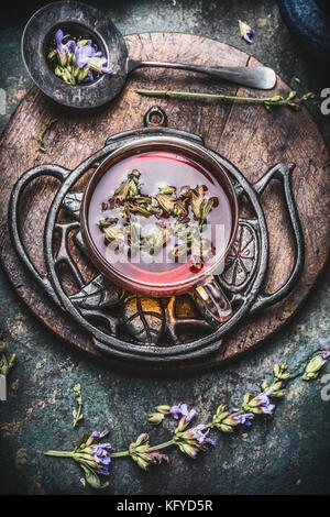 Healthy herbal tea concept , cup of tea with fresh herbs and flowers on rustic vintage background, top view - Stock Photo