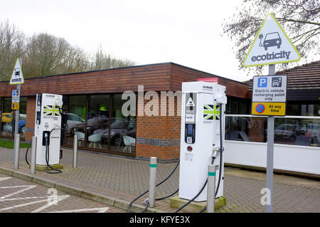 Electric recharging points at a motorway service station in the UK. - Stock Photo