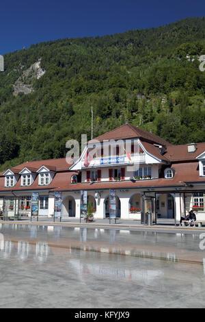 Interlaken Ost or Interlaken East railway station reflected in pool, Interlaken, Switzerland - Stock Photo