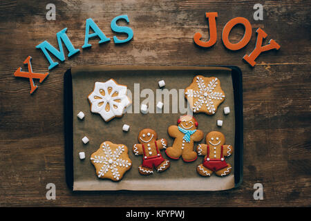 christmas gingerbreads on baking tray  - Stock Photo