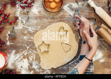 couple cooking gingerbread cookies - Stock Photo