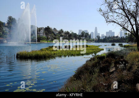 Skyline view of downtown Los Angeles office buildings looking across Echo Park Lake and fountain LA California USA - Stock Photo