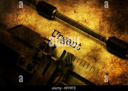 Urgent text on vintage typewriter - Stock Photo