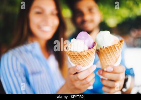 Happy couple having date and eating ice cream - Stock Photo