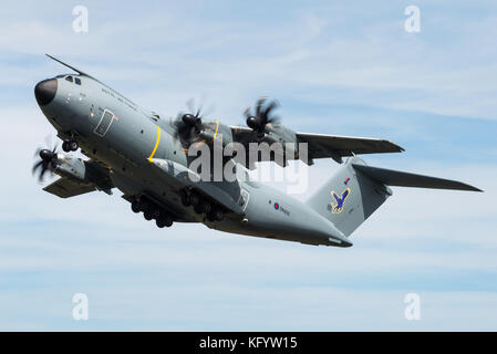 An Airbus A400M military transport aircraft of the 70th Squadron at RAF Brize Norton takes off at RAF Fairford. - Stock Photo