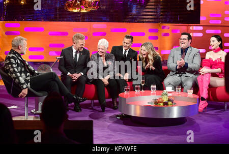 (From the left) Graham Norton, Sir Kenneth Branagh, Dame Judi Dench, Johnny Depp, Michelle Pfeiffer, Josh Gad and St.Vincent appearing on the Graham Norton Show filmed at the London Studios, London.