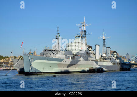 HMS Belfast, River Thames, Pool Of London,  London, UK. Brazilian Navy U27 training ship behind. - Stock Photo