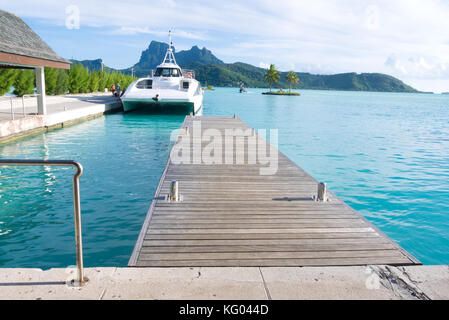 The Bora Bora airport in Motu Mute, French Polynesia caters to both air travel and sea travel with an assortment - Stock Photo