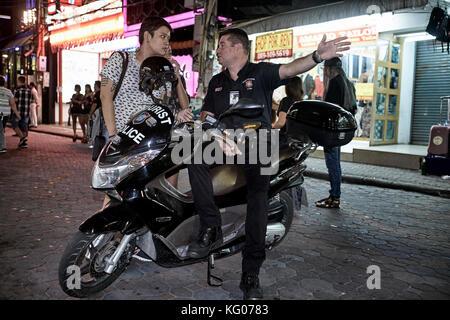 Tourist police volunteer. Walking Street, Pattaya, Thailand. - Stock Photo