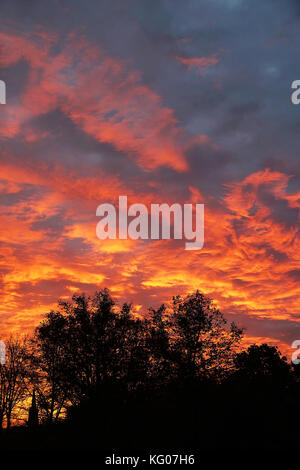 dramatic flaming sky with orange clouds - Stock Photo
