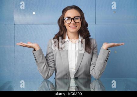 Confident businesswoman welcome gesture - Stock Photo