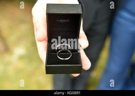 Wedding rings on a wedding day - Stock Photo