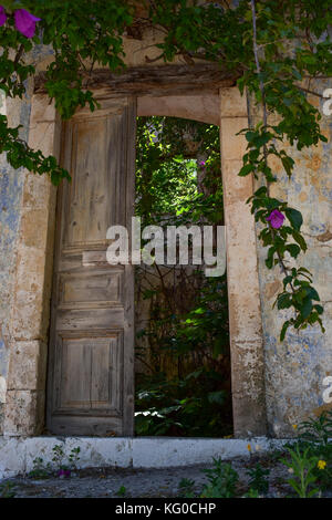An old doorway in Assos on the Greek island of Cephalonia - Stock Photo