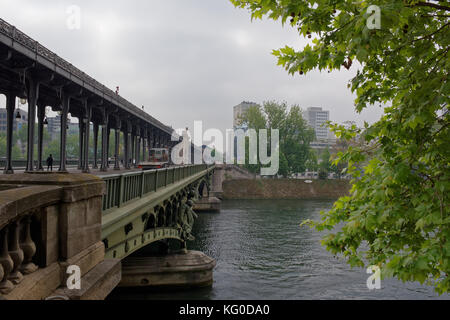 Paris; France-May 05; 2017: View of the Bir-Hakeim bridge. Pedestrians and vehicles are moving along the bridge - Stock Photo