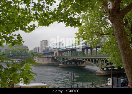Paris; France-May 05; 2017: View of the Bir-Hakeim bridge. Pedestrians are moving along the bridge - Stock Photo