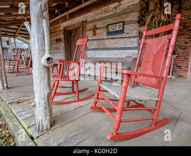 Old Fashioned White Rocking Chairs On The Front Porch Of An Cabin In Rural Alabama