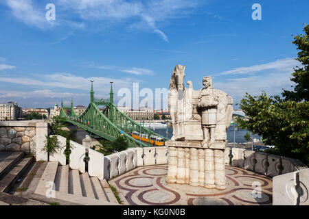 Statue of Szent Istvan Kiraly, King Saint Stephen of Hungary on Gellert Hill and Liberty Bridge in Budapest, Hungary - Stock Photo