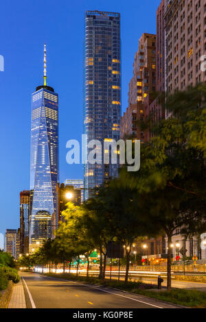 The One World Trade Center and the newly constructed 50 West skyscrapers from West Street at twilight. Manhattan - Stock Photo