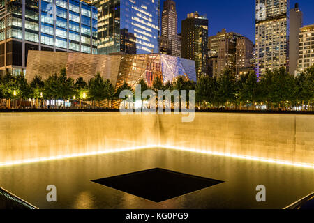 The North Reflecting Pool illuminated at twilight with view of the 9/11 Memorial & Museum. Manhattan Lower Manhattan, - Stock Photo