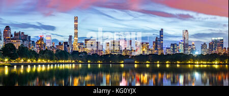 New York City panorama. Jacqueline Kennedy Onassis Reservoir reflects the midtown skyline in Central Park. - Stock Photo