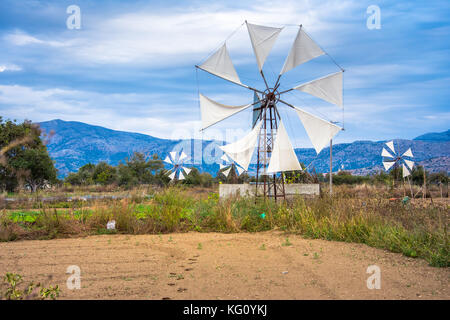 Water pumps driven by wind on the mountain plateau Lasithi in the inland of the island of Crete, Greece - Stock Photo