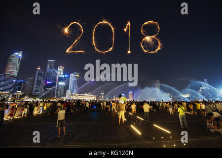 SINGAPORE   AUG 19, 2017 : 2018 Happy New Year Firework Sparkle With  Tourists At