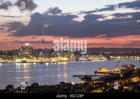 Stunning sunset over the Auckland financial district famous skyline from the viewpoint in Davenport in New Zealand - Stock Photo