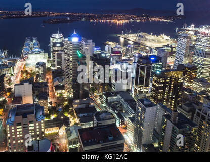 Aerial night view of Auckland financial and business district in New Zealand largest city by the Haruki gulf - Stock Photo