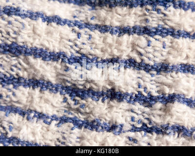 close up of striped blue and white table cloth fabric; essex; england; uk - Stock Photo