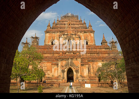 Tourists visiting the Dhammayangyi Temple, largest Buddhist temple in the ancient city Bagan, Mandalay Region, Myanmar - Stock Photo