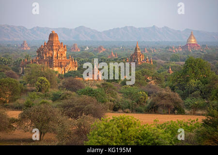 Buddhist temples and pagodas at sunset in the ancient city Bagan / Pagan, Mandalay Region, Myanmar / Burma - Stock Photo