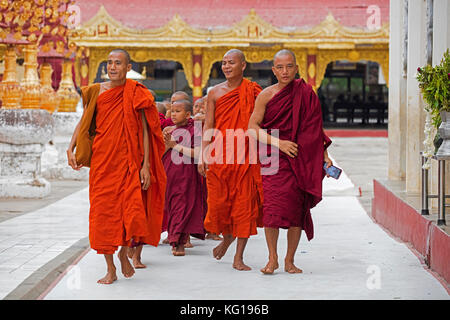 Buddhist monks and novices at the Shwezigon Pagoda / Shwezigon Paya, golden temple in Nyaung-U near Bagan / Pagan, - Stock Photo