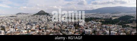 Athens, Greece day view ranging from Mount Lycabettus to Panathenaic Stadium. Panoramic view of Lykavittos hill - Stock Photo