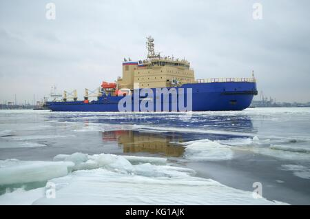 Icebreaker breaks the ice for the free passage of transport ships. - Stock Photo