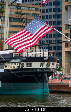 USS Constellation with the Stars and Stripes of the American Flag, Baltimore, Maryland, USA - Stock Photo