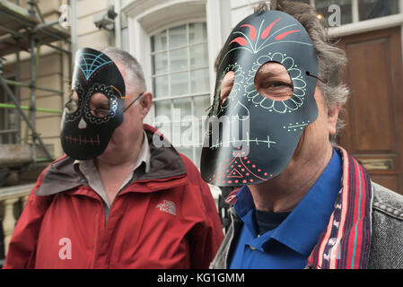 London, UK. 2nd November 2017. Men wear Mexican decorated masks at the Justice Mexico vigil at the Mexican Embassy - Stock Photo