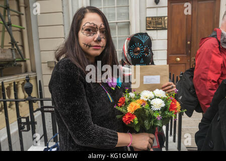 London, UK. 2nd November 2017. A Justice Mexico Now campaigner holds one of the masks she has decorated at the vigil - Stock Photo