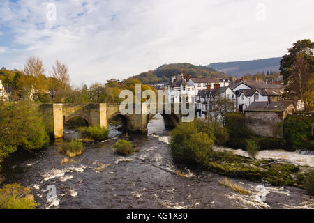 The Dee Bridge in Llangollen one of the Seven Wonders of Wales built in 16th century it is the main crossing point - Stock Photo