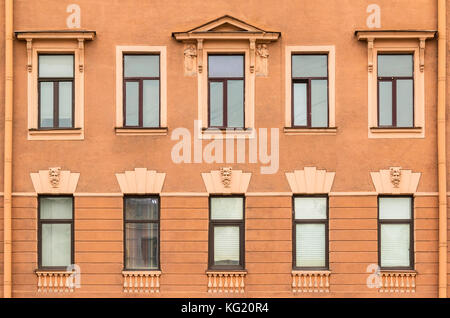 Several windows in a row on facade of urban apartment building front view, St. Petersburg, Russia - Stock Photo